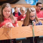 students praying the rosary