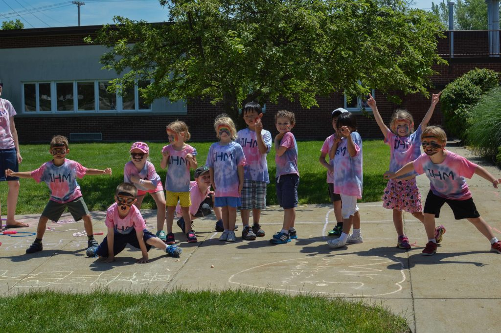 students wearing tie-dyed IHM shirts on field day