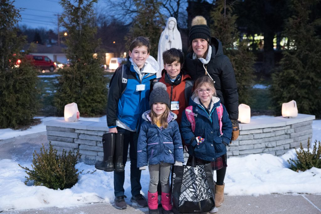 family gathers near Mary statue for Luminaries for Life 2021